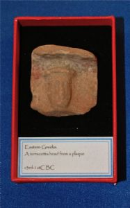 The head segment from an Ancient Greek terracotta votive plaque of the Goddess Astarte. SOLD